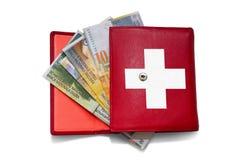 Rode portefeuille Zwitserse frank Stock Fotografie