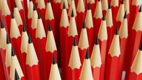 Rode Potloden in een Gelijk Net op een Eenvoudige Concrete Oppervlakte Stock Afbeeldingen