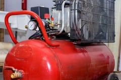 Rode productiecompressor stock afbeelding