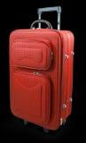Rode reiskoffer Stock Afbeeldingen