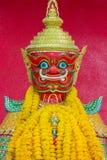 Rode Reus van Thailand met Rode Achtergrond Royalty-vrije Stock Foto's