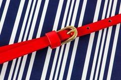 Rode riem op blauw Stock Foto's