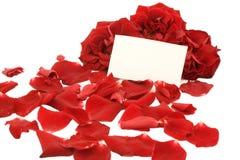 Rode rozen met een lege nota Royalty-vrije Stock Afbeelding