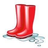 Rode rubberlaarzen in plons van water Royalty-vrije Stock Foto