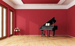 Rode ruimte met grote piano Stock Afbeeldingen