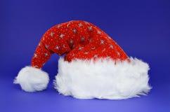 Rode santahoed op blauw Royalty-vrije Stock Foto's