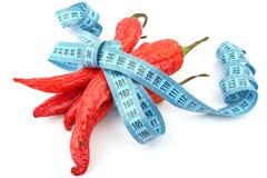Rode Spaanse peperspeper en meter Royalty-vrije Stock Foto's