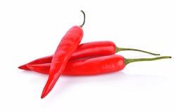 Rode Spaanse peperspeper op witte achtergrond Royalty-vrije Stock Foto's