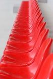 Rode stadionzetels Stock Foto's