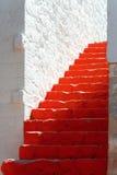 Rode stappen stock afbeelding