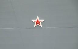 Rode ster op de schil stock fotografie