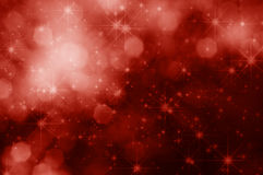 Rode Sterren en Bokeh-Kerstmisachtergrond Royalty-vrije Stock Afbeeldingen