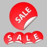 Rode sticker met de tekst van verkoop Royalty-vrije Stock Foto's