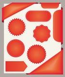 Rode stickers, referenties en linten. Stock Foto