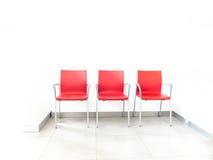 Rode stoel drie op een rij Royalty-vrije Stock Foto