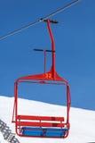 Rode stoel van skilift Stock Afbeelding