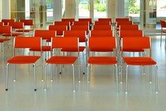 Rode stoelen Stock Afbeeldingen