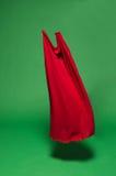 Rode stof in de lucht stock afbeeldingen
