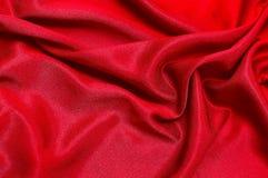 Rode stoffenachtergrond, patroon van zijde of linnen stock fotografie