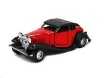 Rode stuk speelgoed auto 1 Stock Afbeelding