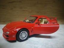 Rode stuk speelgoed auto Stock Foto's
