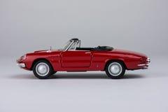 Rode stuk speelgoed auto royalty-vrije stock afbeelding