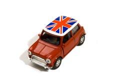 Rode stuk speelgoed auto met Britse vlag Royalty-vrije Stock Foto's