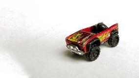 Rode stuk speelgoed auto op wit geïsoleerde achtergrond royalty-vrije stock foto's