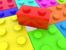 Rode stuk speelgoed baksteen tussen kleurrijke bakstenen royalty-vrije illustratie