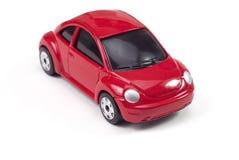 Rode stuk speelgoed economieauto Royalty-vrije Stock Foto
