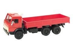 Rode stuk speelgoed vrachtwagen Stock Afbeeldingen