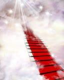 Rode tapijt en wolken stock afbeeldingen