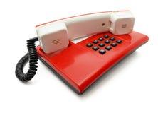 Rode telefoon met zwarte knopen Stock Foto
