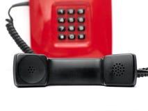 Rode telefoon over wit Stock Fotografie