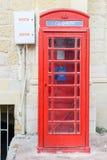 Rode telefooncabine in Victoria in Gozo-eiland, Malta royalty-vrije stock foto's