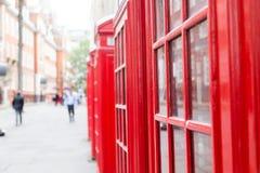 Rode Telefooncellen en Exemplaarruimte Royalty-vrije Stock Fotografie