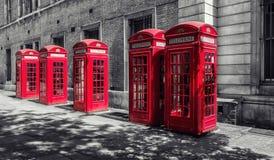 Rode telefooncellen in Londen, het UK Royalty-vrije Stock Foto's