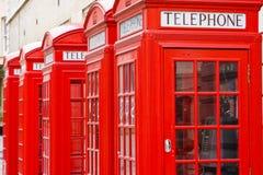 Rode telefoondozen Stock Foto's
