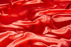 Rode textielachtergrond Royalty-vrije Stock Afbeeldingen
