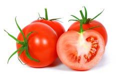 Rode tomatengroente met besnoeiing Stock Afbeeldingen