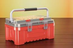 Rode toolbox op de houten lijst, het 3D teruggeven Stock Foto's