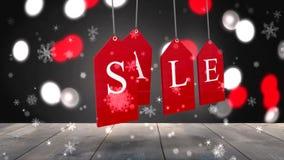 Rode verkoopmarkeringen die tegen gloeiende achtergrond hangen stock illustratie