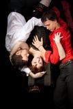 Rode vrouw in masker en twee mannen - liefdedriehoek Royalty-vrije Stock Foto