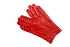 Rode vrouwelijke handschoenen die op een wit worden geïsoleerdb Royalty-vrije Stock Foto's
