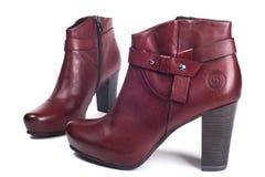 Rode vrouwelijke laarzen Stock Foto's