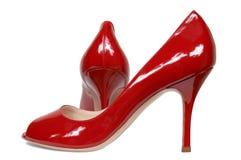 Rode vrouwelijke schoenen royalty-vrije stock afbeeldingen
