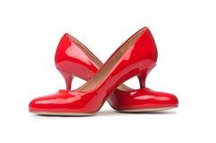 Rode vrouwenschoenen Royalty-vrije Stock Afbeeldingen