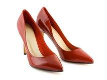 Rode vrouwenschoenen stock afbeelding