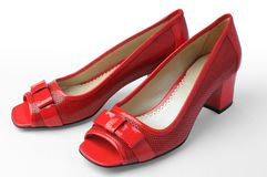 Rode vrouwenschoenen Stock Foto's