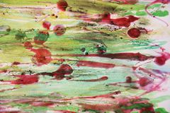 Rode was en gebrand document met groene waterverftinten Stock Foto